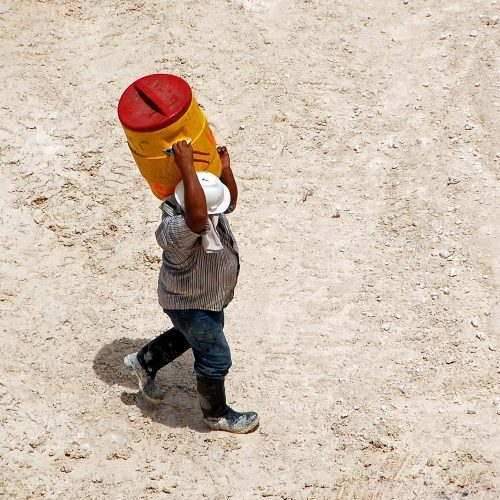 construction worker holding water jug